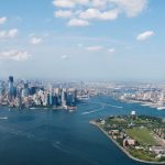 new york harbor showing governors island and the manhattan skyline